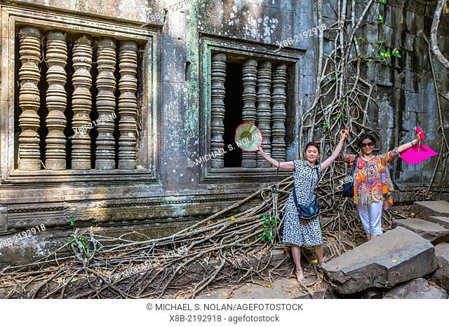 Tourists at Beng Mealea Temple, overgrown and falling down, Angkor, Siem Reap Province, Cambodia (Khmer)