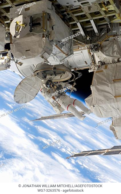 EARTH -- 18 Dec 2006 -- Astronaut Robert L Curbeam Jnr, STS-116 mission specialist, exits the Quest Airlock of the International Space Station as he and...