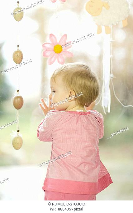 Little Girl Looking At Easter Decoration, Osijek, Croatia, Euope
