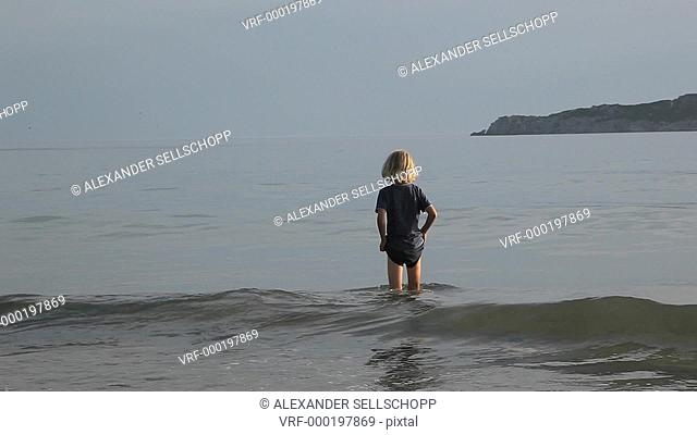 WS, Handheld, A boy running out of the sea