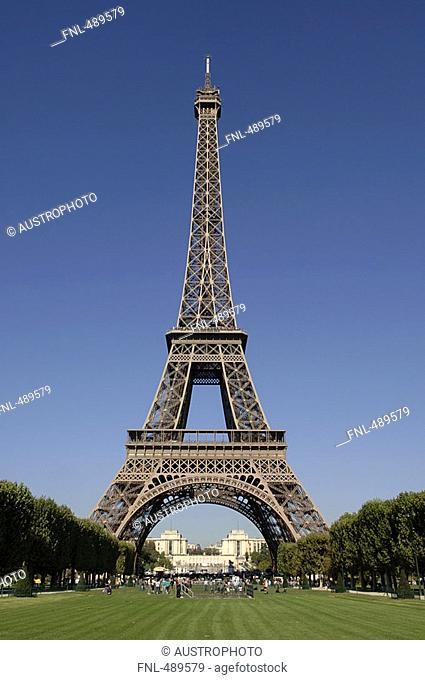 Tourists near tower against sky, Eiffel Tower, Paris, France