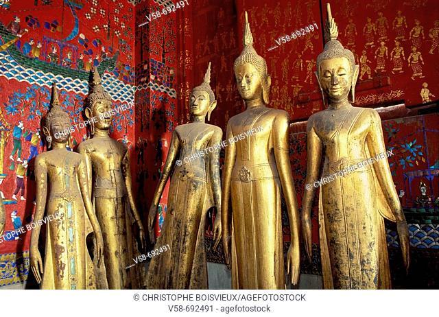 Golden Buddhas in the calling for rain posture at Wat Xieng Thong temple, Luang Prabang. Laos