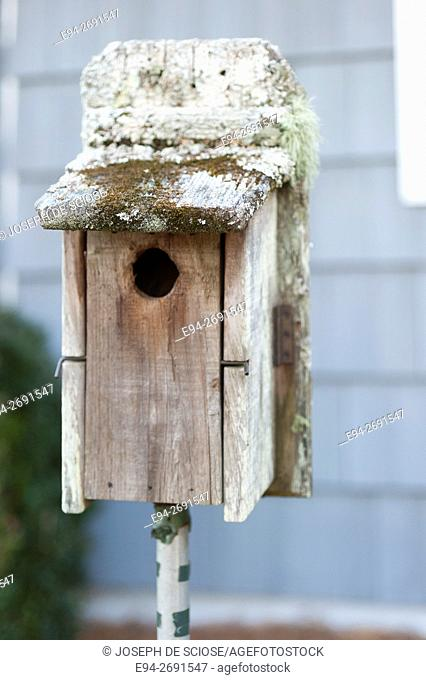 A bird house in the front yard of a home. Birmingham, Alabama, USA