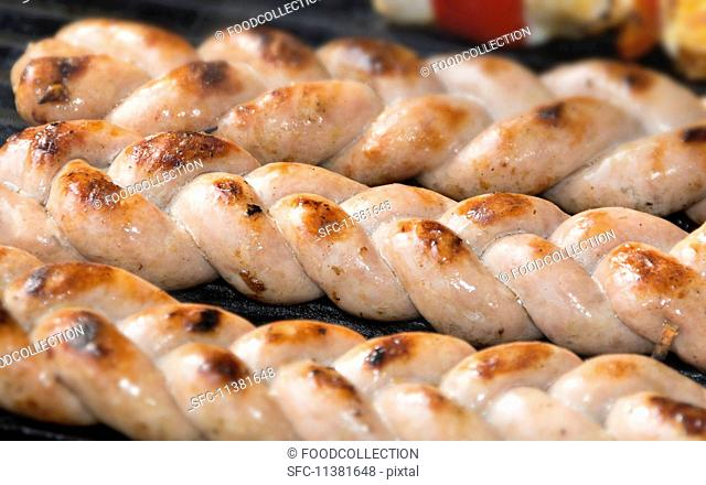 Sausage braids on a grill
