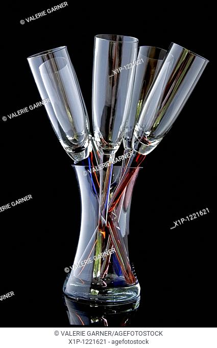 This unique glass stemware are 5 wineglasses in a bouquet type setting, within a glass vase holder These are empty and sparkling clean isolated on a black...