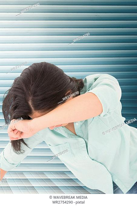 Grief distressed woman against blue background