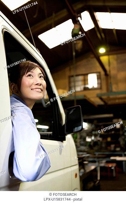 Female Car Mechanic In Car