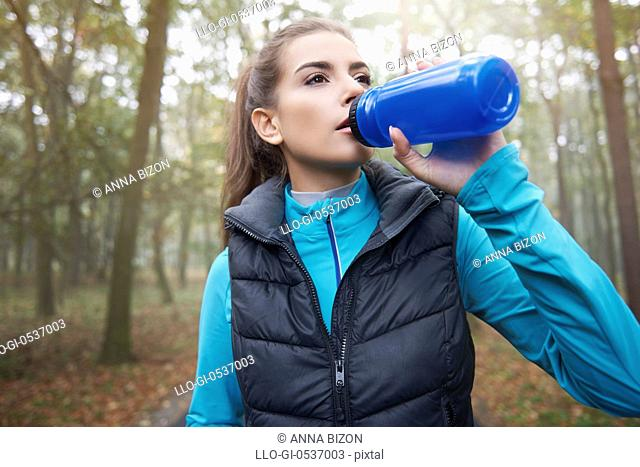 Thirsty woman after training hard. Debica, Poland