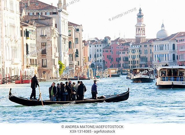 Local gondola ride across Canal Grande Venice Italy