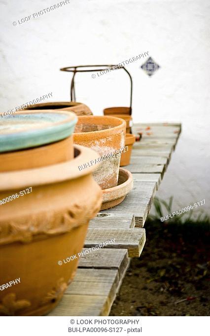 Empty Terra Cotta Pots on Wood Deck