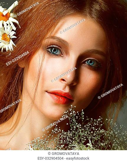 Freshness. Portrait of Romantic Redhead Woman with Chamomile
