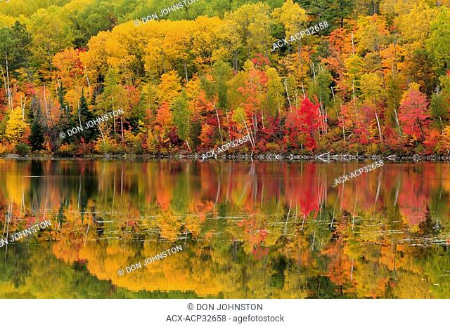 Autumn reflections in Apsey Lake. Espanola, Ontario, Canada