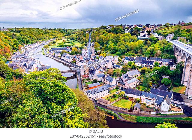 Aerial view of the historic town of Dinan with Rance river with dramatic cloudscape, Cotes-d'Armor department. Brittany (Bretagne), France