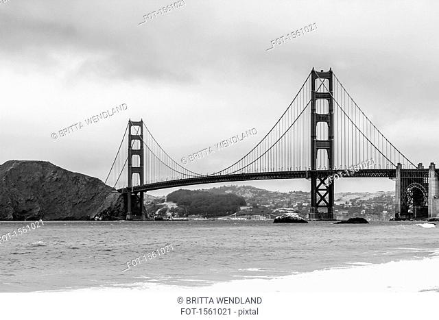View of Golden Gate Bridge over bay of water against sky, San Francisco, California, USA
