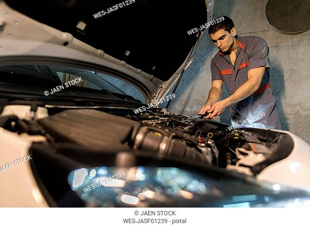 Mechanic repairing car in a garage