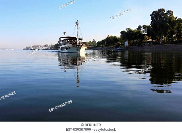 a cruise ship is leaving the harbour of Luxor to Aswan in the morning, Egypt