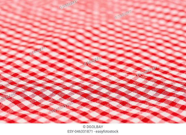 Checkered tablecloth kitchen selective focus. the white and red checkered background. Selective focus