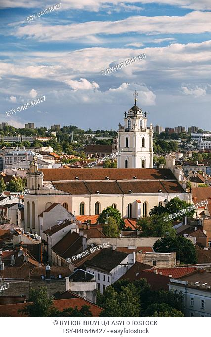 Vilnius, Lithuania. View Of Bell Tower And Church Of St. Johns, St. John The Baptist And St. John The Apostle And Evangelist In Old Town