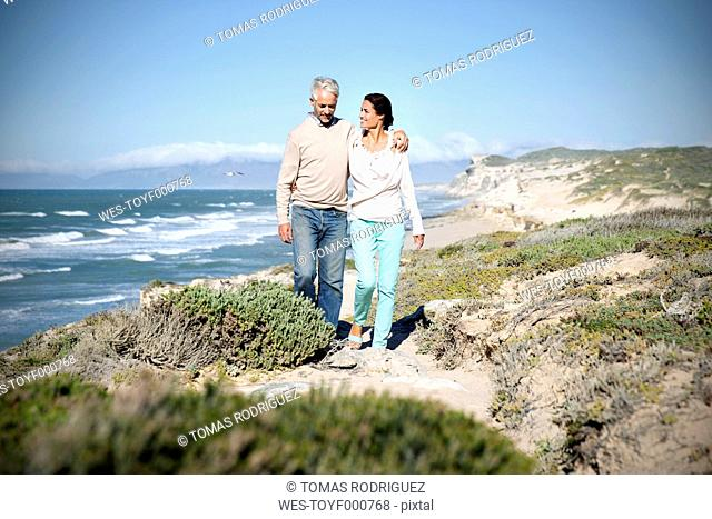South Africa, couple walking along the coast