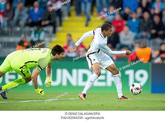 France's Kylian Mbappe (r) scores to make it 0:2 against Croatia's goalkeeper Karlo Letica, during the UEFA European Under-19 Championship group B soccer match...