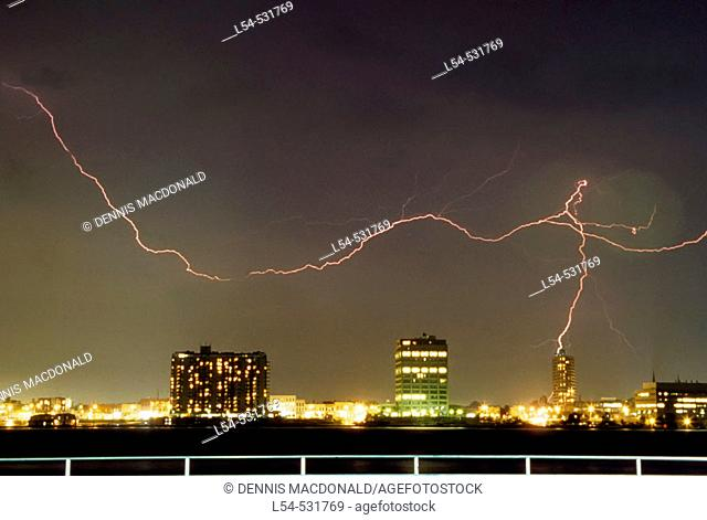 Lightening bolts strike the water over St Petersburg Florida