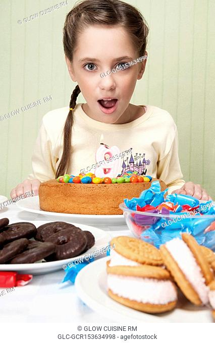 Portrait of a girl with a birthday cake