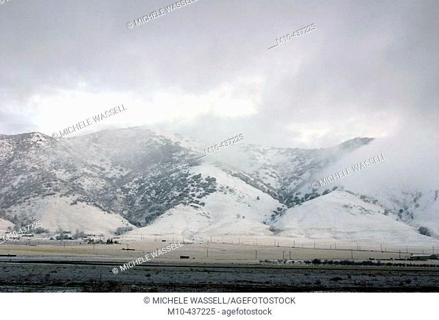 Tehachapi Mountains in the winter with snow and clouds over them