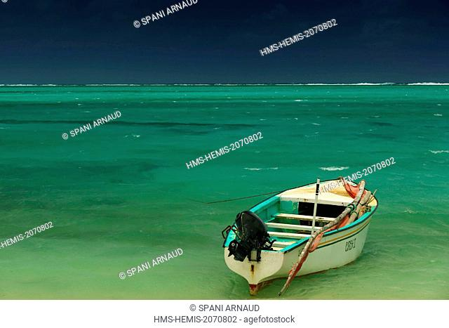 Mauritius, Rodrigues Island, ile aux Chats, fishing boat in the lagoon under a stormy sky
