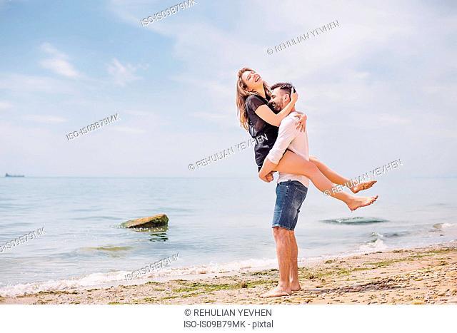 Couple on beach, Odessa, Ukraine