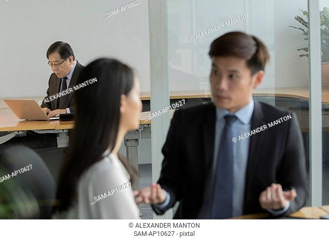 Singapore, Three business people in office