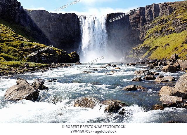 Gufufoss waterfall above the village of Seydisfjordur, Eastern Fjords, Iceland