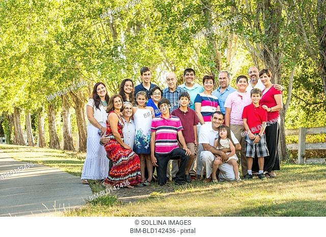 Extended family posing together outdoors