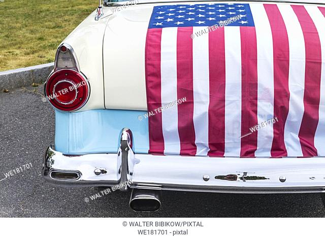 USA, New England, Massachusetts, Essex, antique cars, detail of 1950s-era Ford draped with US flag