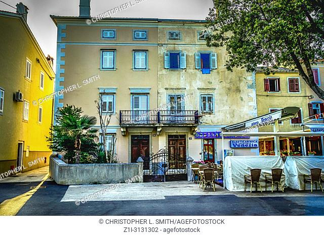 Ice cream shop and other buildings on the waterfront at Punat on the Croatian island of Krk