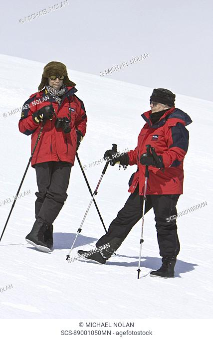 Lindblad Expeditions guests on slope in Antarctica as part of expedition travel NO MODEL RELEASES FOR THIS IMAGE