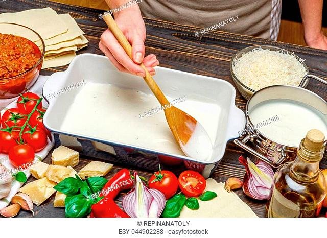 Preparation of homemade lasagna. Italian pasta recipe with tomato sauce and minced meat