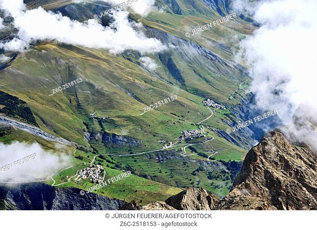 Villages get small over the clouds, alpine world of the valley La Romanche, La Grave, Hautes-Alpes, French Alps, France