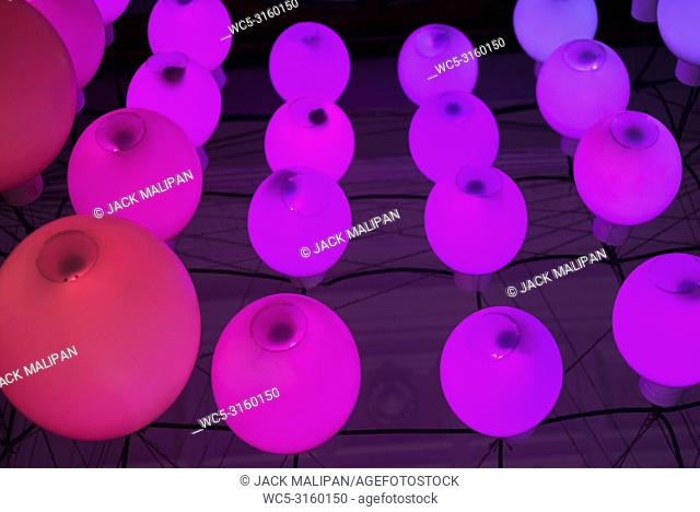 colourful round pink lights in funky modern interior design detail