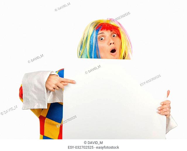 Funny clown point to the blank board
