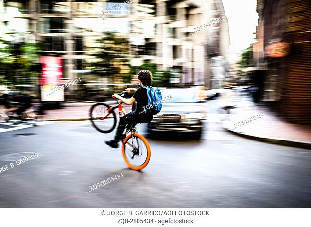 American boys doing stunts on the bicycle in the streets of Boston