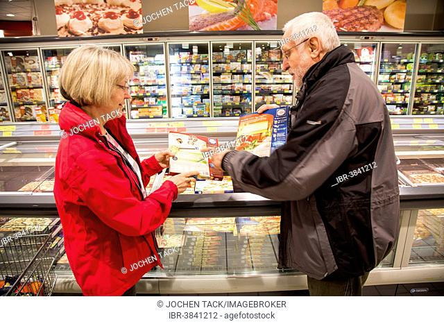 Senior couple shopping in the frozen food section in a supermarket, Germany