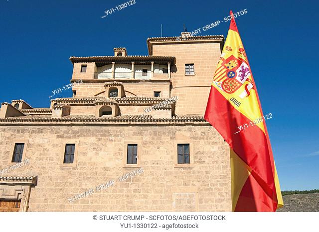 Spanish National Flag fly outside the Basilica-Santuario de la Santisma y Vera Cruz within the castle walls at Caravaca de la Cruz, Murcia, Spain