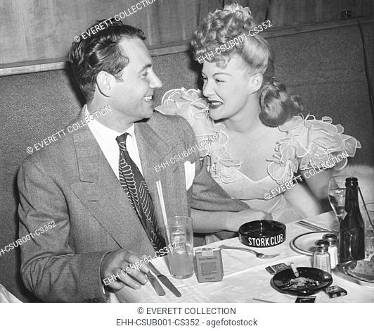 Movie star Betty Hutton with her fiance, newscaster, in Charles Martin at the Stock Club. New York City, Sept. 2, 1943. They never wed