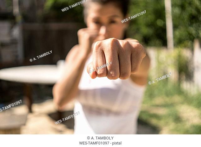 Fist of selfdefending young woman, close-up