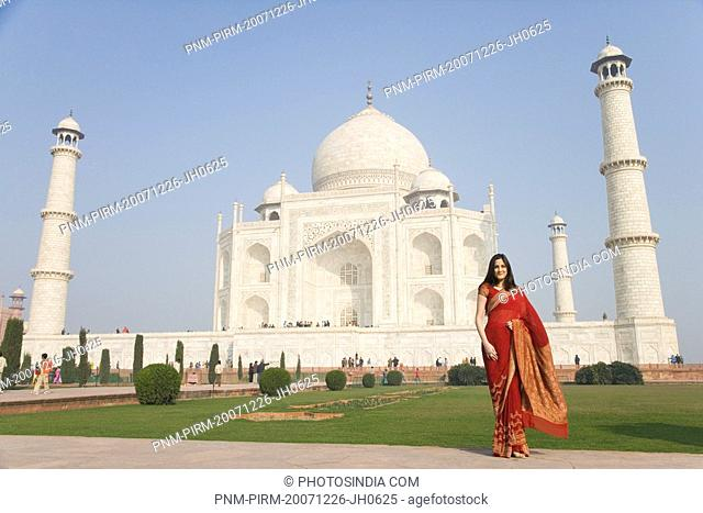 Woman standing in front of a mausoleum, Taj Mahal, Agra, Uttar Pradesh, India