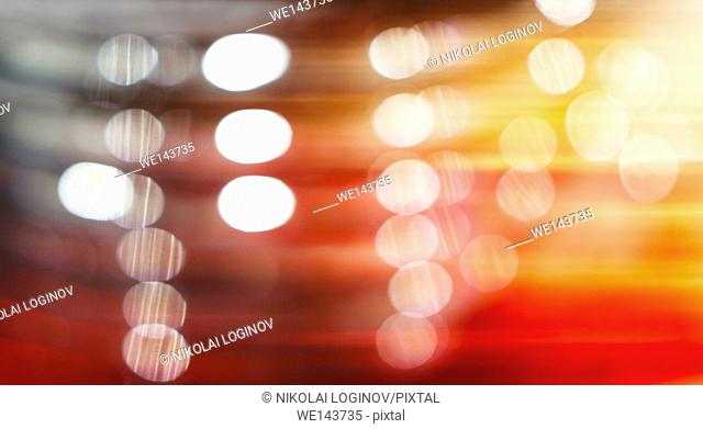 Horizontal vivid orange red bokeh with light leak backdrop