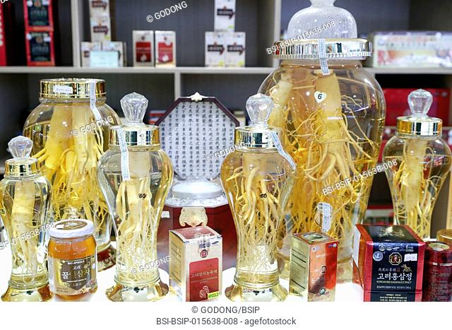 Ginseng (Panax ginseng). Roots of different shape and sizes in alcohol for sale. Ho Chi Minh City. Vietnam