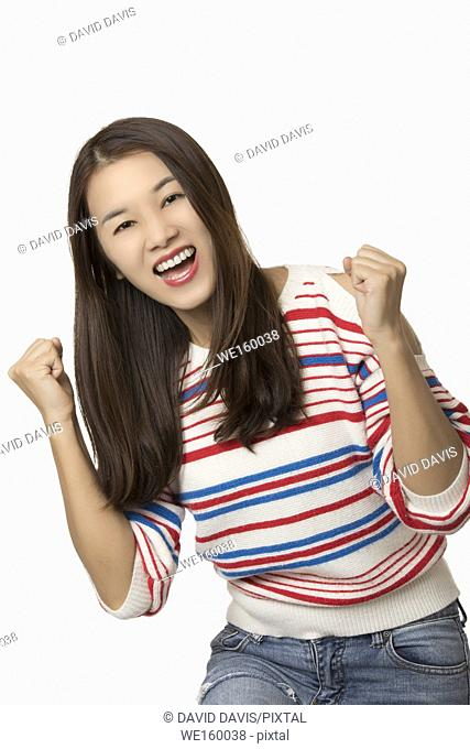 Portrait of a Beautiful Chinese American woman displaying a bit of happy attitude isolated on a white background