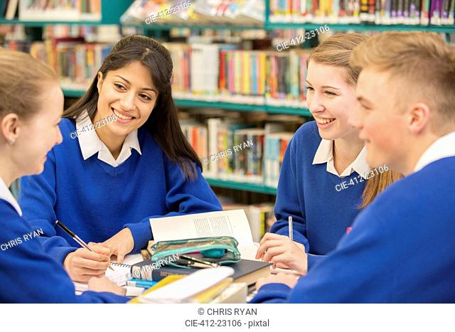 Teenage students learning in library