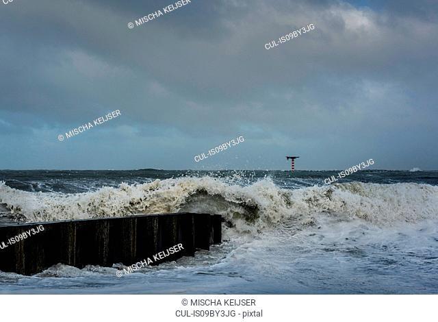 Large waves crashing on dutch shore on stormy day, Rotterdam, Zuid-Holland, Netherlands